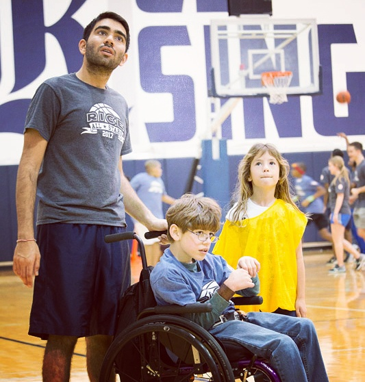 Picture of my kids, Noah in the wheelchair and Maya playing basketball.